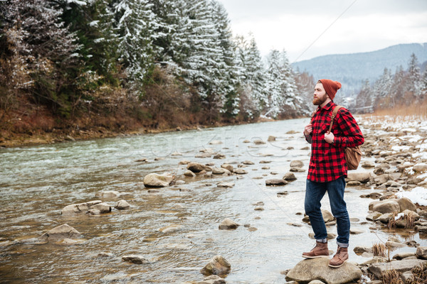 Male hiker walking on the river Stock photo © deandrobot
