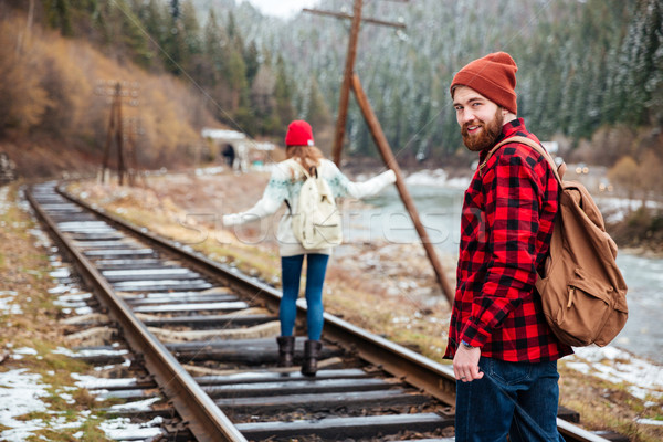 Man and woman walking on old railroad in mountains Stock photo © deandrobot