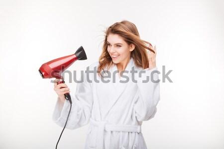Gyönyörű érzéki fiatal nő fürdőköpeny hajszárító fehér Stock fotó © deandrobot