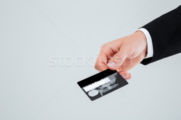 Stock photo: Hand of businessman in suit holding credit card