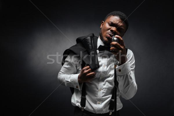Człowiek śpiewu vintage mikrofon afro ciemne Zdjęcia stock © deandrobot
