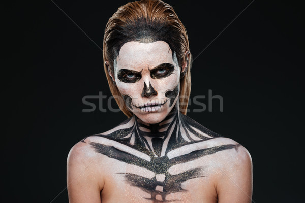 Angry young woman with gothic halloween makeup Stock photo © deandrobot