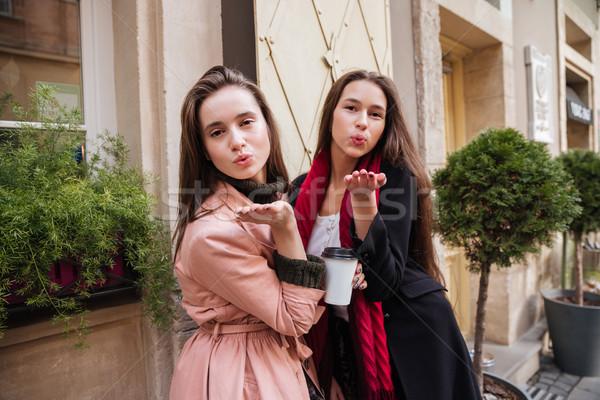 Happy sisters in coats Stock photo © deandrobot
