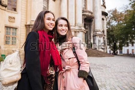 Pretty girls in coats makes selfie Stock photo © deandrobot