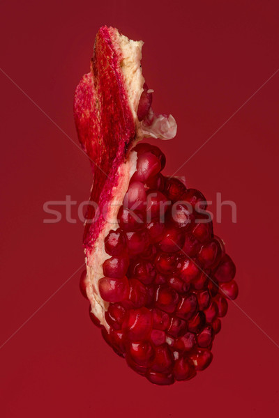 Ripe pomegranate fruit segment isolated Stock photo © deandrobot