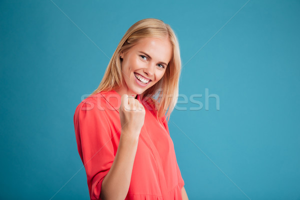 Portrait of excited delighted young woman celebrating success Stock photo © deandrobot