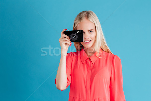 Young pretty girl taking photo using camera Stock photo © deandrobot
