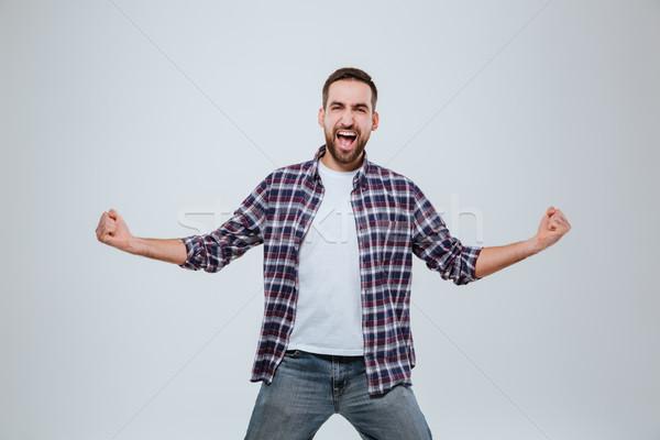 кричали счастливым бородатый человека рубашку студию Сток-фото © deandrobot