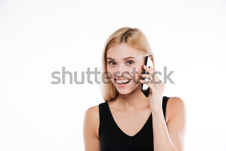 Cheerful fitness lady talking by mobile phone. Stock photo © deandrobot