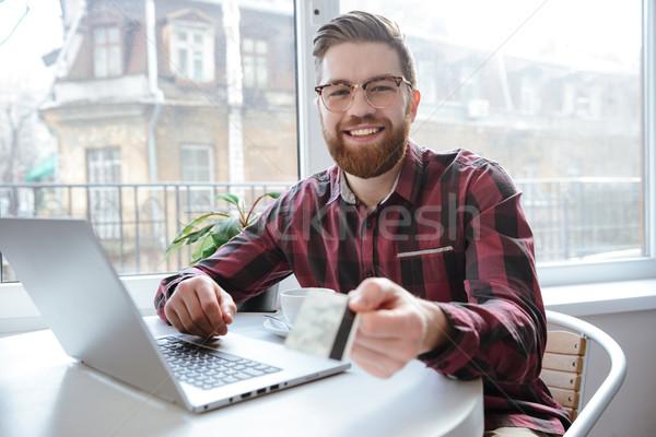 бородатый молодым человеком дебетовая карточка Сток-фото © deandrobot