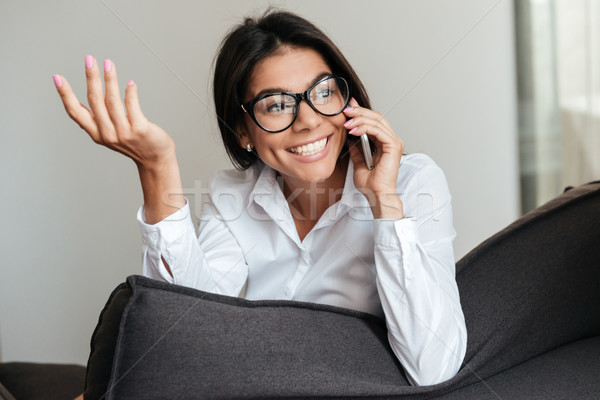 Pretty smiling business woman talking on mobile phone Stock photo © deandrobot