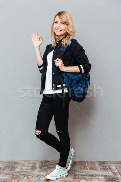 Happy young lady with backpack Stock photo © deandrobot