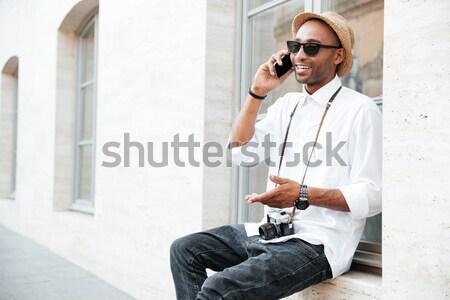 Portré mosolyog vonzó fiatalember kabát napszemüveg Stock fotó © deandrobot