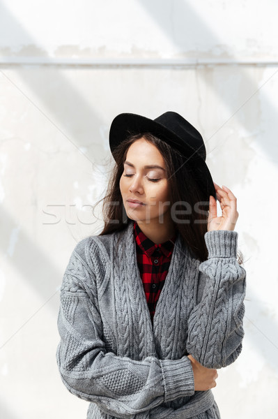Portrait of woman standing with pleasure against sun Stock photo © deandrobot