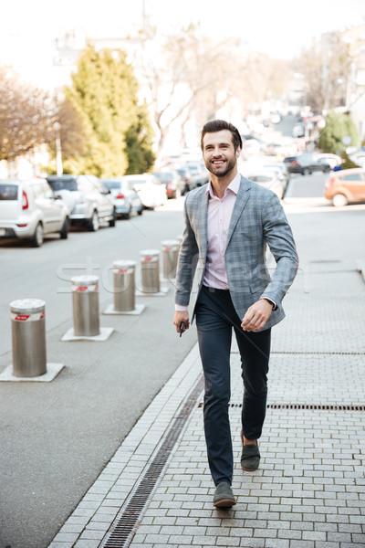 肖像 笑みを浮かべて ハンサムな男 ジャケット 幸せ ストックフォト © deandrobot