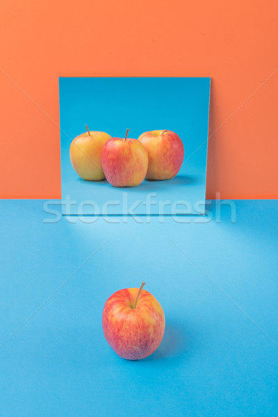 Apfel blau Tabelle isoliert orange Bild Stock foto © deandrobot