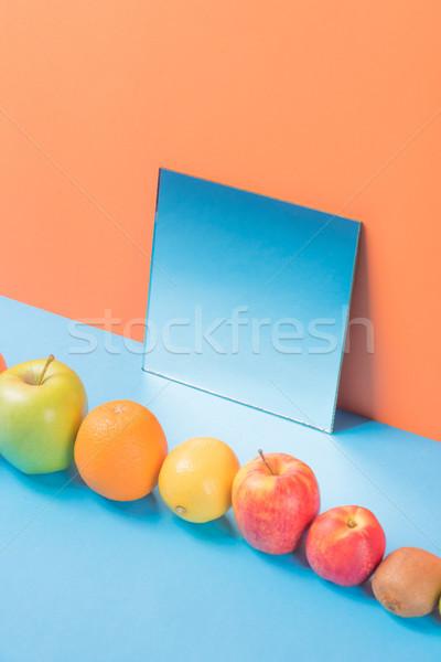 Vruchten Blauw tabel geïsoleerd oranje foto Stockfoto © deandrobot