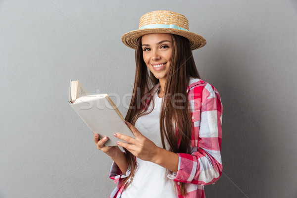 Close up portrait of a smiling happy woman in straw hat holding  Stock photo © deandrobot