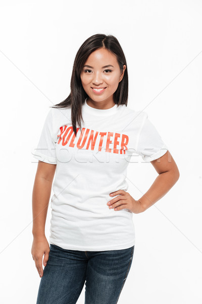 Portrait of a smiling casual asian woman in volunteer t-shirt Stock photo © deandrobot