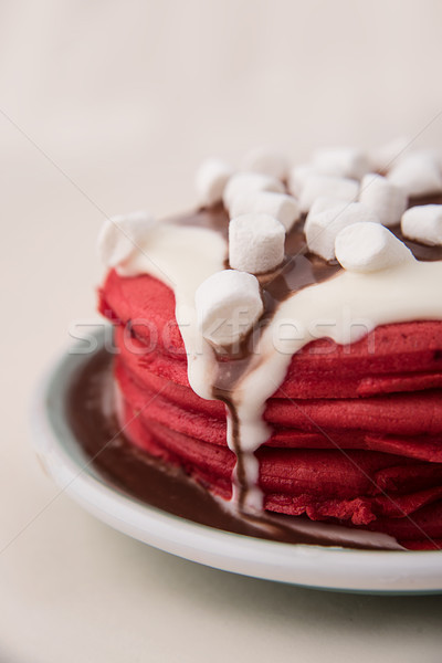 Shot of red pancakes in plate Stock photo © deandrobot