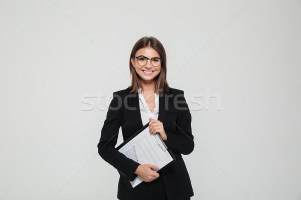 портрет удовлетворенный молодые деловая женщина костюм очки Сток-фото © deandrobot