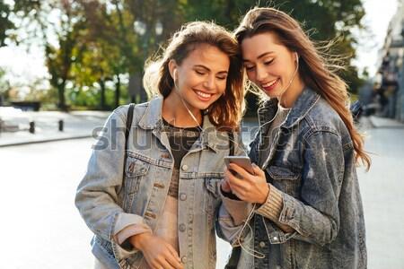 Dois alegre morena mulher jeans jaqueta Foto stock © deandrobot