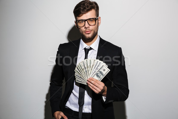 Portrait of a confident successful man in suit and eyewear Stock photo © deandrobot