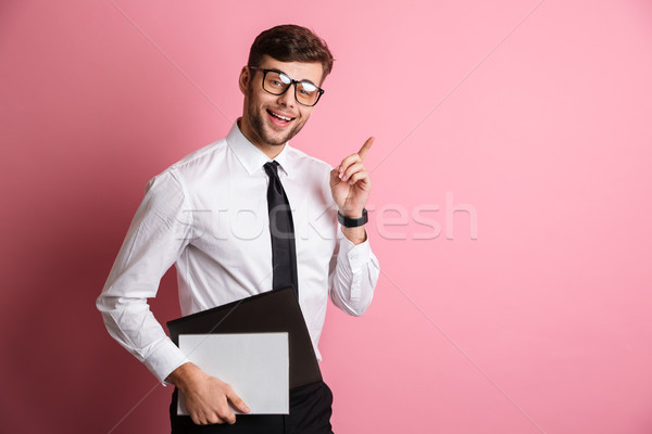 Portrait of a smiling attractive man in white shirt Stock photo © deandrobot