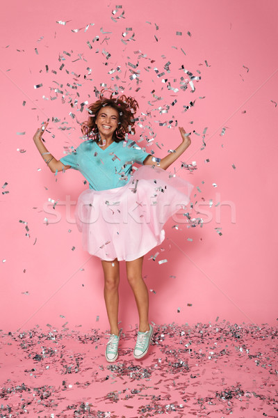 Full length photo of happy birthday girl having fun with sequins Stock photo © deandrobot