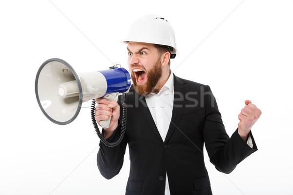 öfkeli sakallı iş adamı kask çığlık atan megafon Stok fotoğraf © deandrobot