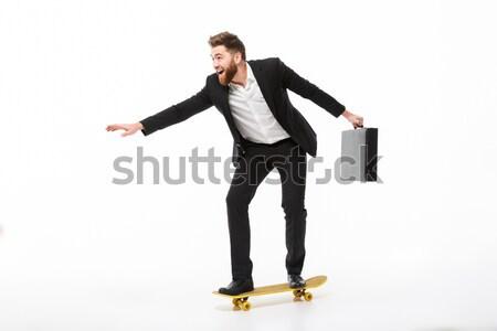 Afbeelding vrolijk bebaarde zakenman aktetas Stockfoto © deandrobot