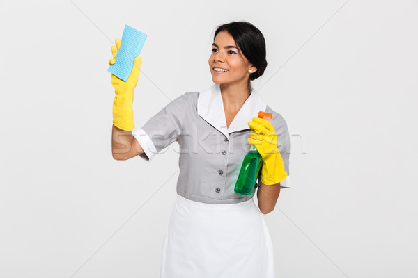 Retrato alegre bastante governanta uniforme limpeza Foto stock © deandrobot