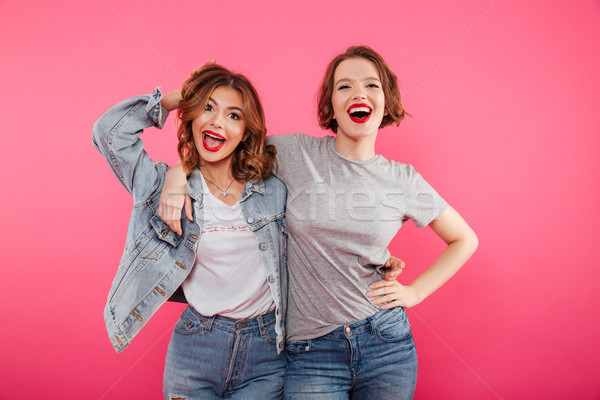 Happy two women friends hugging. Stock photo © deandrobot