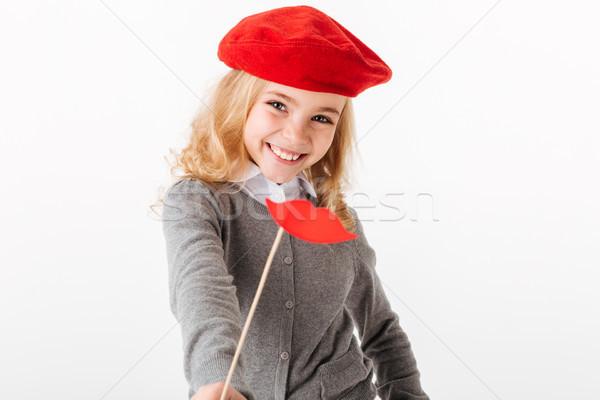 Retrato sonriendo pequeño colegiala uniforme mirando Foto stock © deandrobot