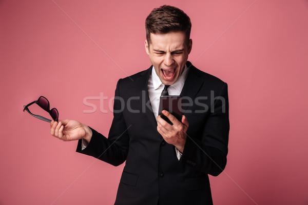 Zły krzyczeć niezadowolony młodych biznesmen mówić Zdjęcia stock © deandrobot