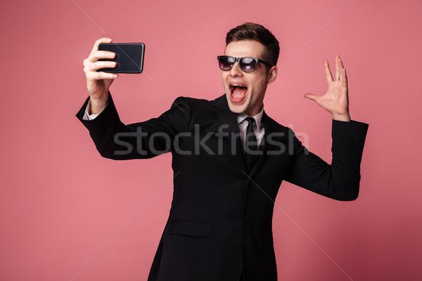 ストックフォト: 面白い · 興奮した · 小さな · ビジネスマン · 携帯電話