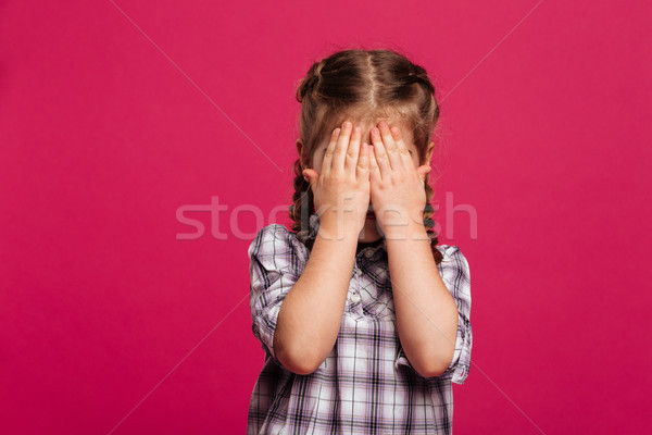 Little girl child standing isolated covering face with hands. Stock photo © deandrobot