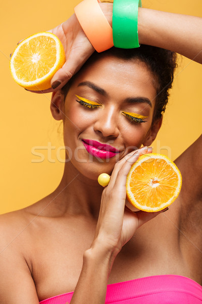 Vertical image of sensual afro american woman with closed eyes h Stock photo © deandrobot