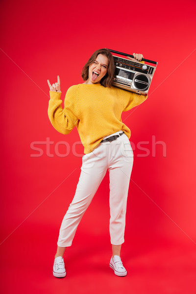 Full length portrait of a cheerful girl with a boombox Stock photo © deandrobot