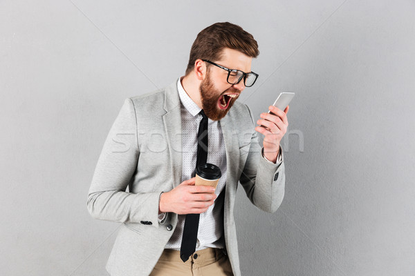 Portrait of a furious businessman dressed in suit Stock photo © deandrobot