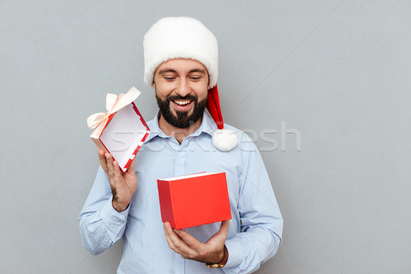 Smiling Bearded man in business clothes and christmas hat Stock photo © deandrobot
