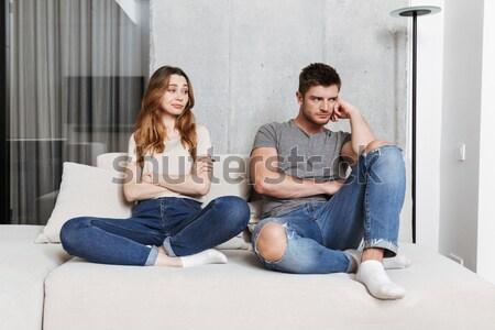 Jeunes affectueux couple séance canapé Photo stock © deandrobot