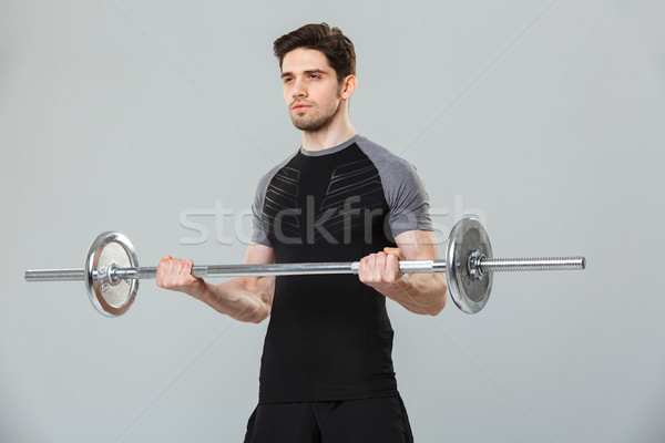 Portrait of a focused young sportsman Stock photo © deandrobot