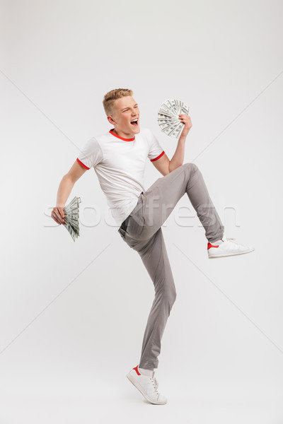 Full length portrait of successful young man wearing casual clot Stock photo © deandrobot