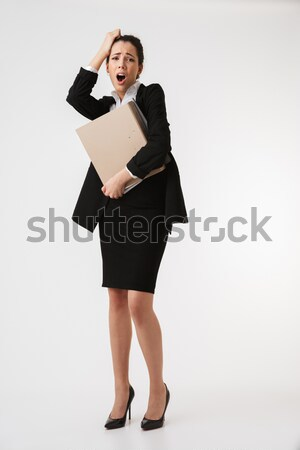 Full length portrait of a young woman Stock photo © deandrobot