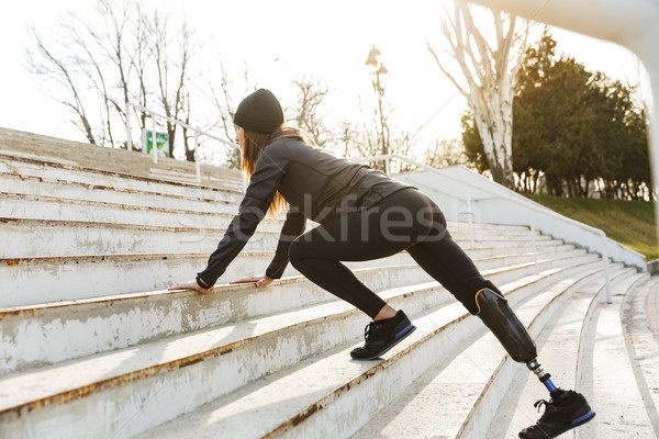 Image of disabled running girl with prosthetic leg in sportswear Stock photo © deandrobot