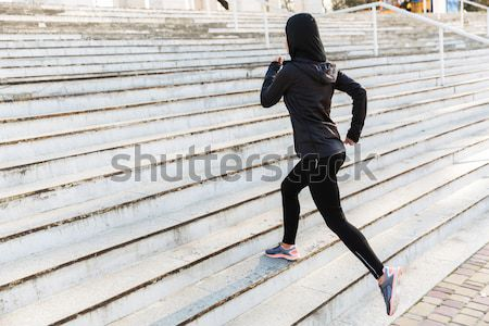 Image of disabled running girl in sportswear, training and stret Stock photo © deandrobot