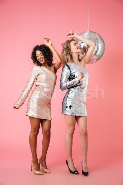 Full length of two beautiful cheery women Stock photo © deandrobot