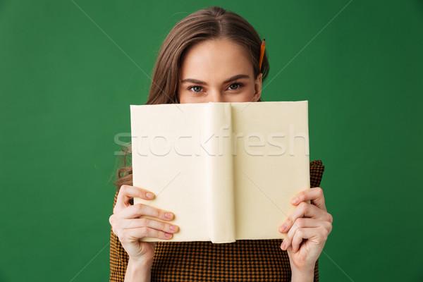 Genç kadın ayakta yalıtılmış yeşil görüntü Stok fotoğraf © deandrobot