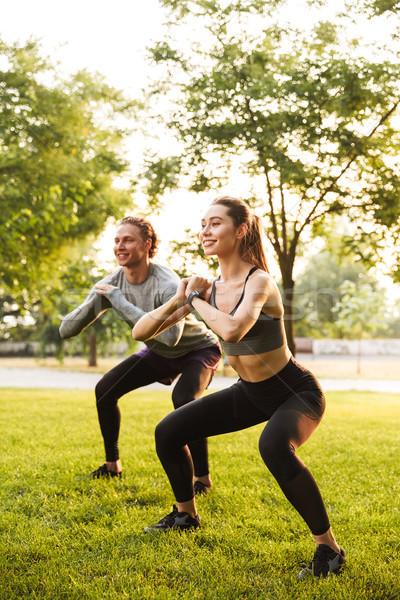 Sport loving couple friends in park Stock photo © deandrobot